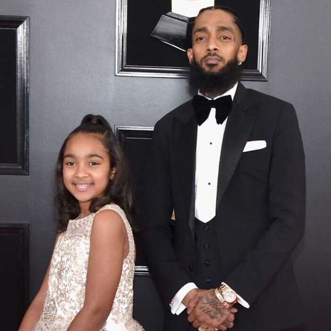 Nipsey Hussle and his daughter Emani Asghedom