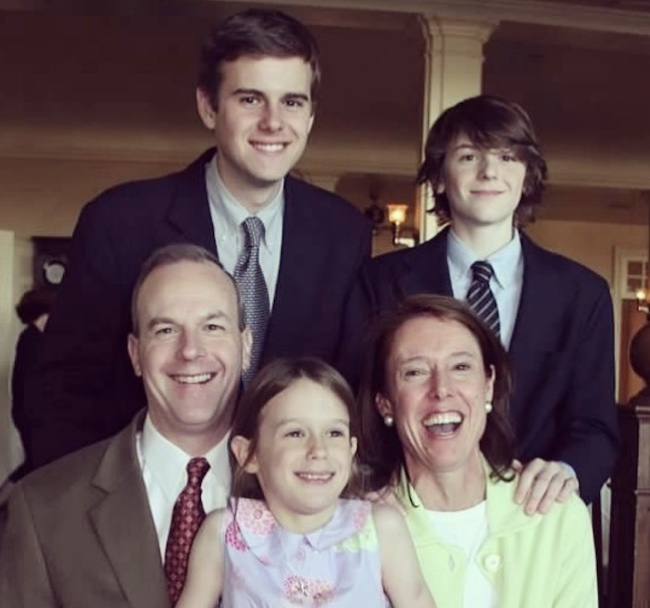 Young Guy Benson with his family